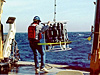 Launching a CTD device off a ships's fantail.