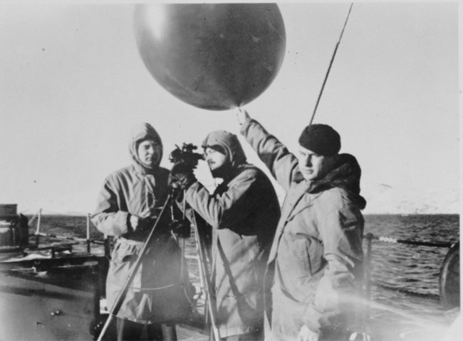 An undated photograph of a weather balloon being launched from a Coast Guard vessel Credit: NOAA